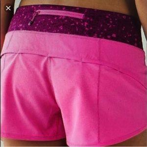 Bright pink lululemon shorts with purple pattern